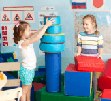 children playing blocks of toys